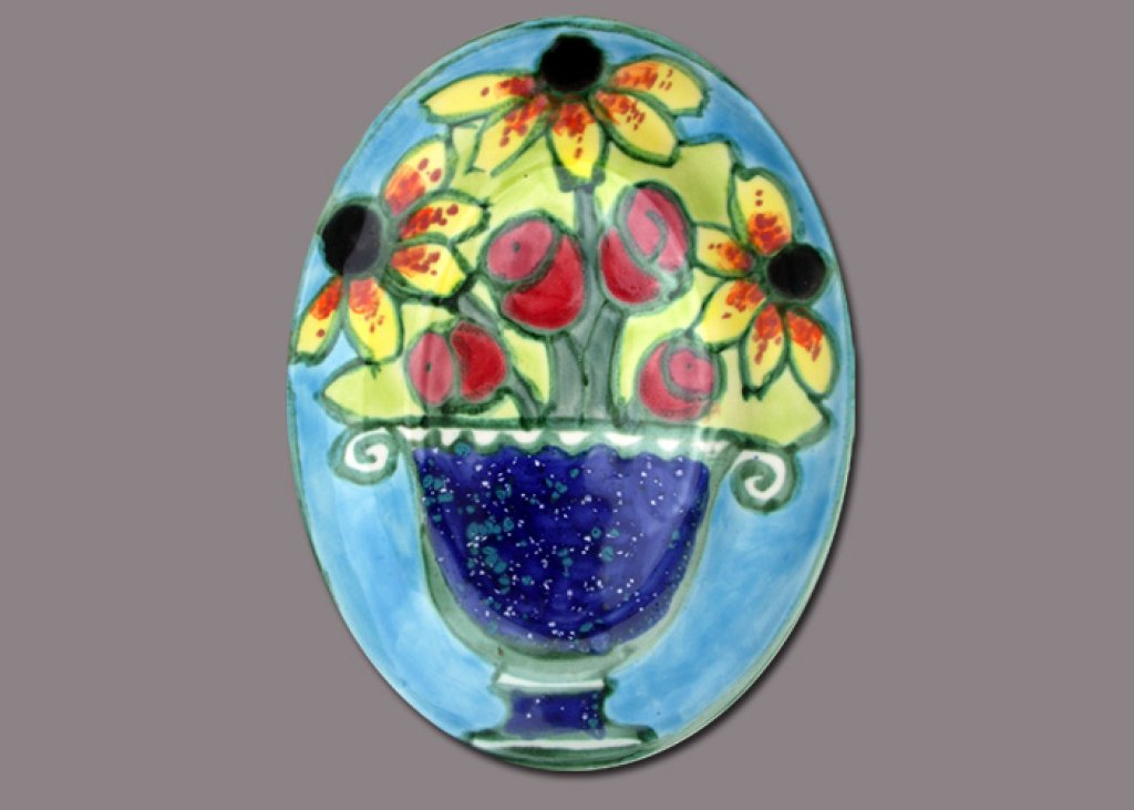 Blackeyed Susan and Tulips in a blue Vase